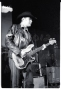 """Nice image of one of the founding members of the band, who rarely tours with them any longer. Nice guy as well: gave me a """"Honky Tonkin' with the Mekons"""" cap that I still have, in return for a stack of cassettes for them to play on the road.... Live at the I-Beam, SF May 4, 1987"""