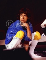 Mick Jagger pouts in blue crouching [The Rolling Stones - Rupp A