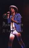 Mick Jagger straw hat strides the stage [The Rolling Stones - Rupp Arena, Lexington Ky 12-11-81]