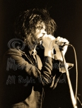 Nick Cave two hands on mic eyes closed & hair tussled [Nick Cave & The Bad Seeds - I Beam, SF 10-28-86]