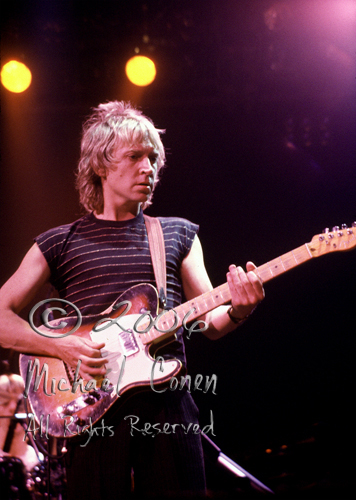 "Andy Summers in a well-lit moment.  One of the few frames where you can ""just"" spot Stewart Copeland in the background"