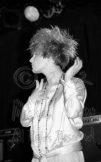Liz Fraser closeup profile with hands alight [Cocteau Twins - Wo