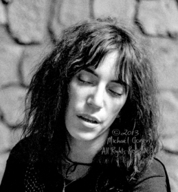 "Patti Smith Group Bogart's Cincinnati, Ohio 2-16-78 *** Patti Smith Group; Bogart's; Cincinnati; Ohio; 2-16-78; Any further use requires permission from the photographer; Michael Conen. *** These photos were taken on print film, and then digitally scanned at 2000 dpi. All images viewed here are ""proofs"" of the negatives. Serious inquiries regarding further publication will be entertained. Please contact me with comments, questions, etc. at michaelconen@myway.com"