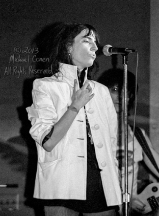 "Patti Smith Group Bogart's Cincinnati, Ohio 2-16-78 *** Patti Smith Group; Bogart's; Cincinnati; Ohio; 2-16-78; Any further use requires permission from the photographer; Michael Conen. *** These photos were taken on print film, and then digitally scanned at 2000 dpi. All images viewed here are ""proofs"" of the negatives. Serious inquiries regarding further publication will be entertained. Please contact me with comments, questions, etc. at michaelconen@tutanota.com"
