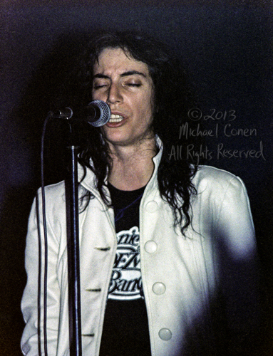 Michael Conen - [PROOF] Patti Smith white jacket eyes closed Col