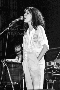 """The Patti Smith Group Memorial Auditorium Louisville, Kentucky 4-26-78 *** The Patti Smith Group; Memorial Auditorium; Louisville; Kentucky; 4-26-78; Any further use requires permission from the photographer; Michael Conen. *** These photos were taken on print film, and then digitally scanned at 2000 dpi. All images viewed here are """"proofs"""" of the negatives. Serious inquiries regarding further publication will be entertained. Please contact me with comments, questions, etc. at michaelconen@tutanota.com"""
