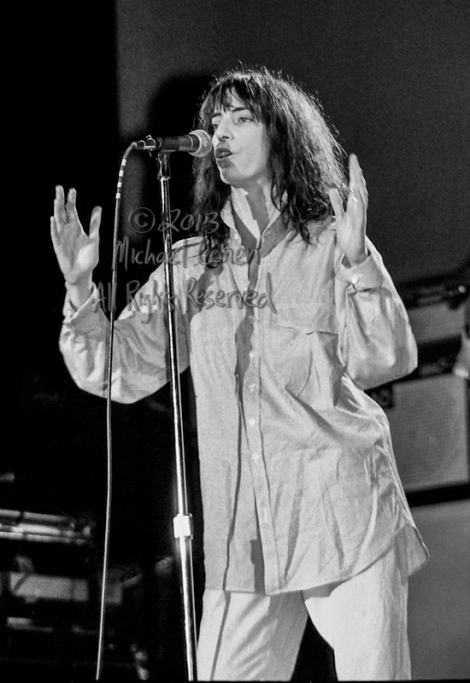 Michael Conen - [PROOF] Patti Smith vocals hands raised LG [Patt