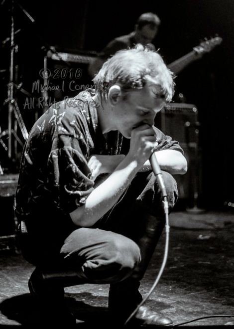 Michael Conen - [PROOF] Mark E. Smith crouching full frame LG [t