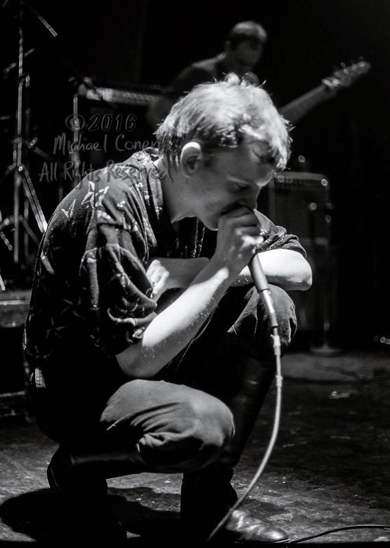 Michael Conen - [PROOF] Mark E. Smith crouching full frame LG [t