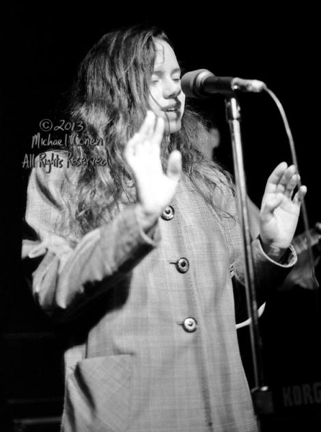 Michael Conen - [PROOF] Natalie Merchant hands raised in overcoa